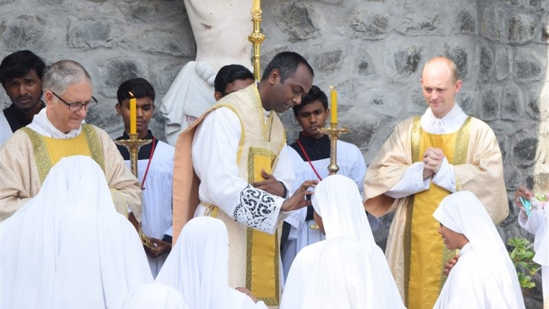 Sister Maria Michaela receives blessing from Father Therasian