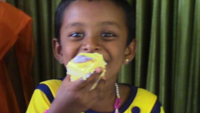 Little Poorvika enjoying her cake..