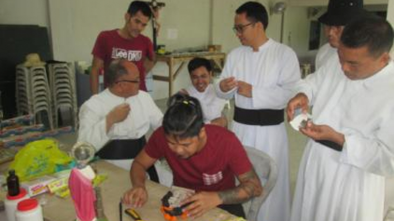 The Brothers receiving instruction on making moulds
